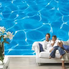 Фотообои в гостиной с рисунком летнего лазурного моря