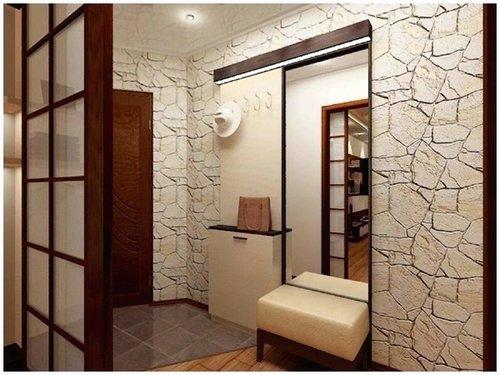 Использование вместо стены раздвижной ширмы позволяет естественному свету проникать в прихожую