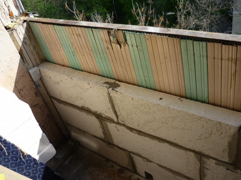 Обшивка парапета балкона..