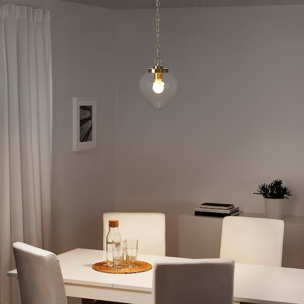 Подвесной светильник в интерьере обеденной зоны