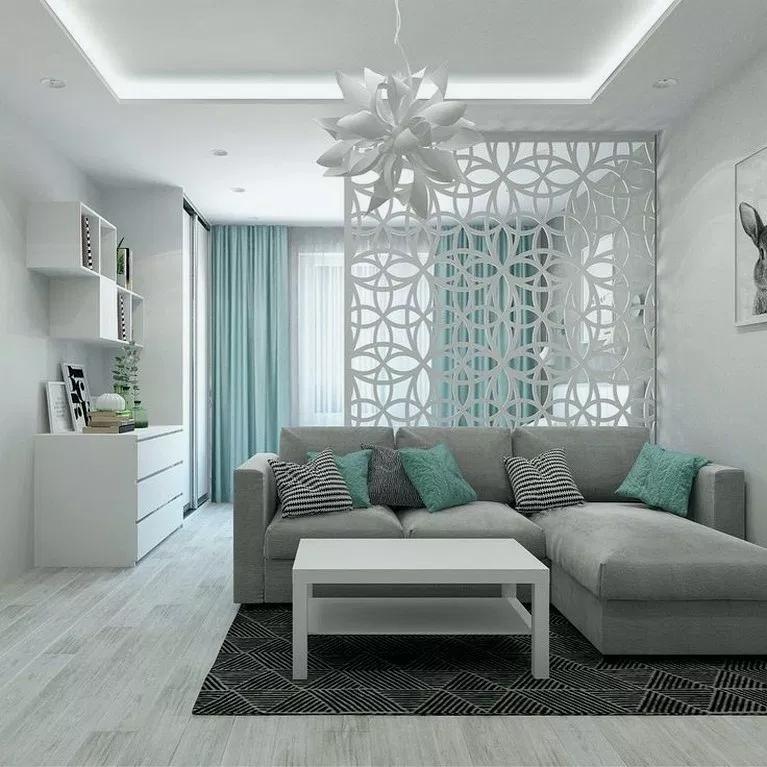 Современный домашний текстиль в интерьере гостиной комнаты