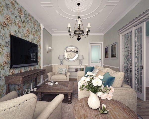 Крупные цветы на стене в сочетании с антикварной мебелью говорят о принадлежности гостиной к стилю прованс.