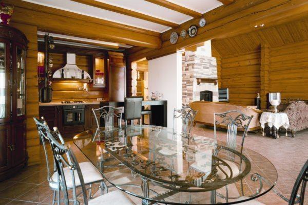 На фото — вариант зонирования гостиной и кухни