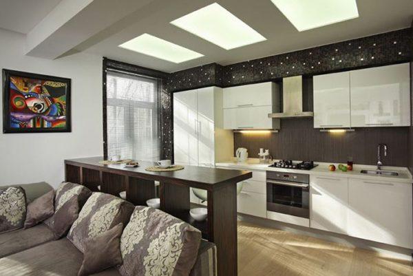 Объединение кухни с гостиной — отличный прием «раздвинуть» стены.