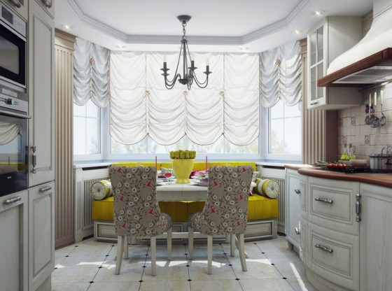 Пример удачного дизайна кухни-студии: в эркере объединены зона отдыха и обеденная группа