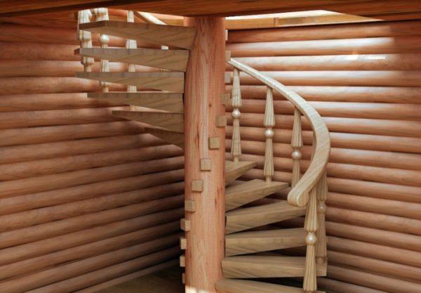 Винтовая лестница в прихожей частного дома. Все ступени крепятся к осевой части